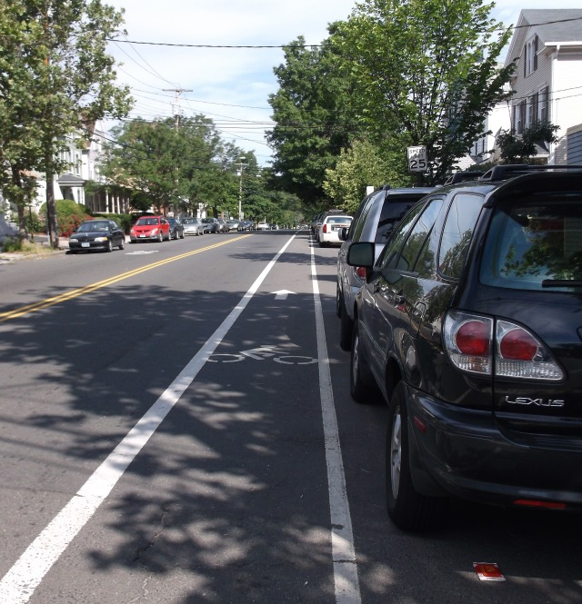 "Bike lane is squeezed between travel and parking lanes, creating a serious ""dooring"" hazard."